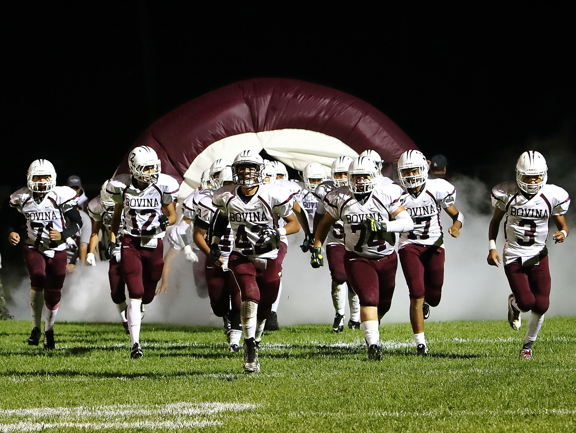 Football team running on to field