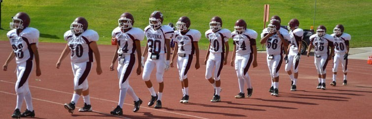 Football Players walking on the track
