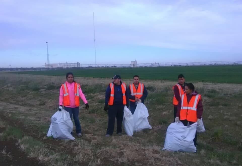 Student Council Members picking up trash along hiway 86
